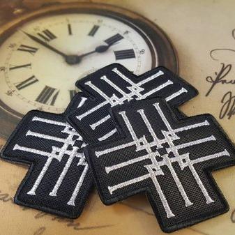 Metsatoll symbol Tikitud embleem